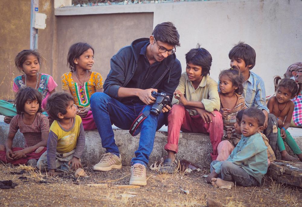 Photographer Navjyot Vyas with children. Photo: Ashish Joshi Ajess