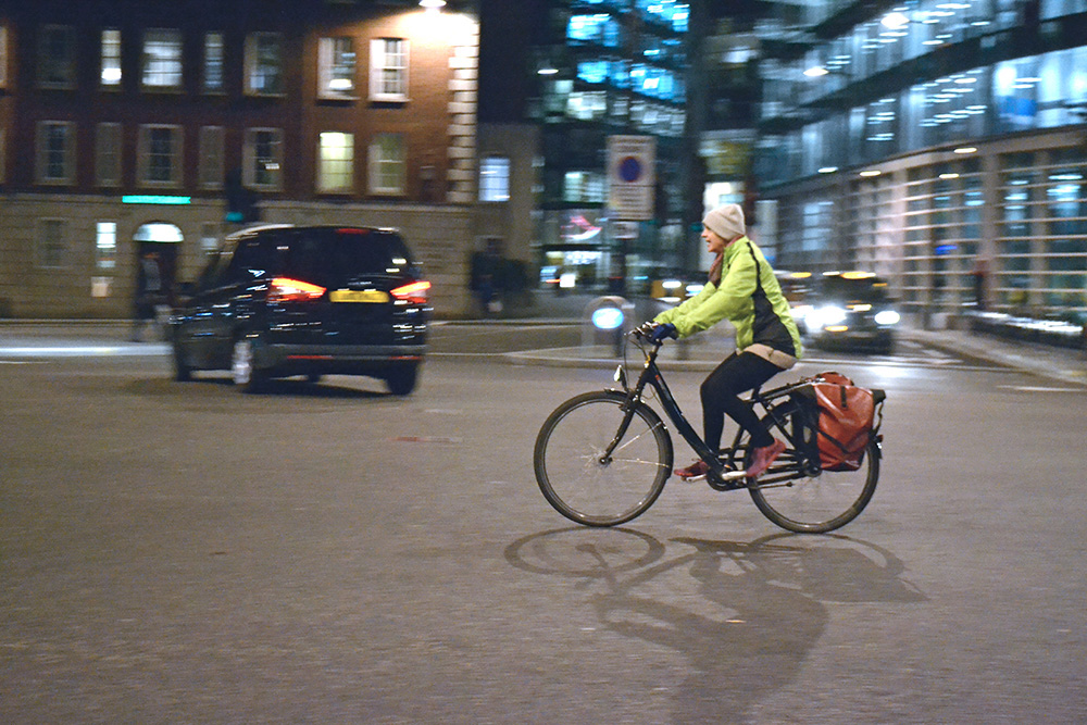 A woman cycling on bike in London street. Photo: Barbora Zelenkova, London, 2016.