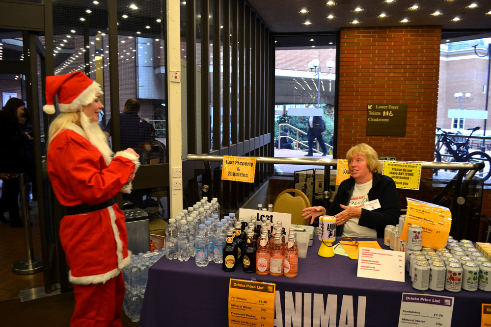 Santa next to the stand of Animal Aid with Vegan drinks (water, ginger beer etc.). Photo: Barbora Sajmovicova, 2015.