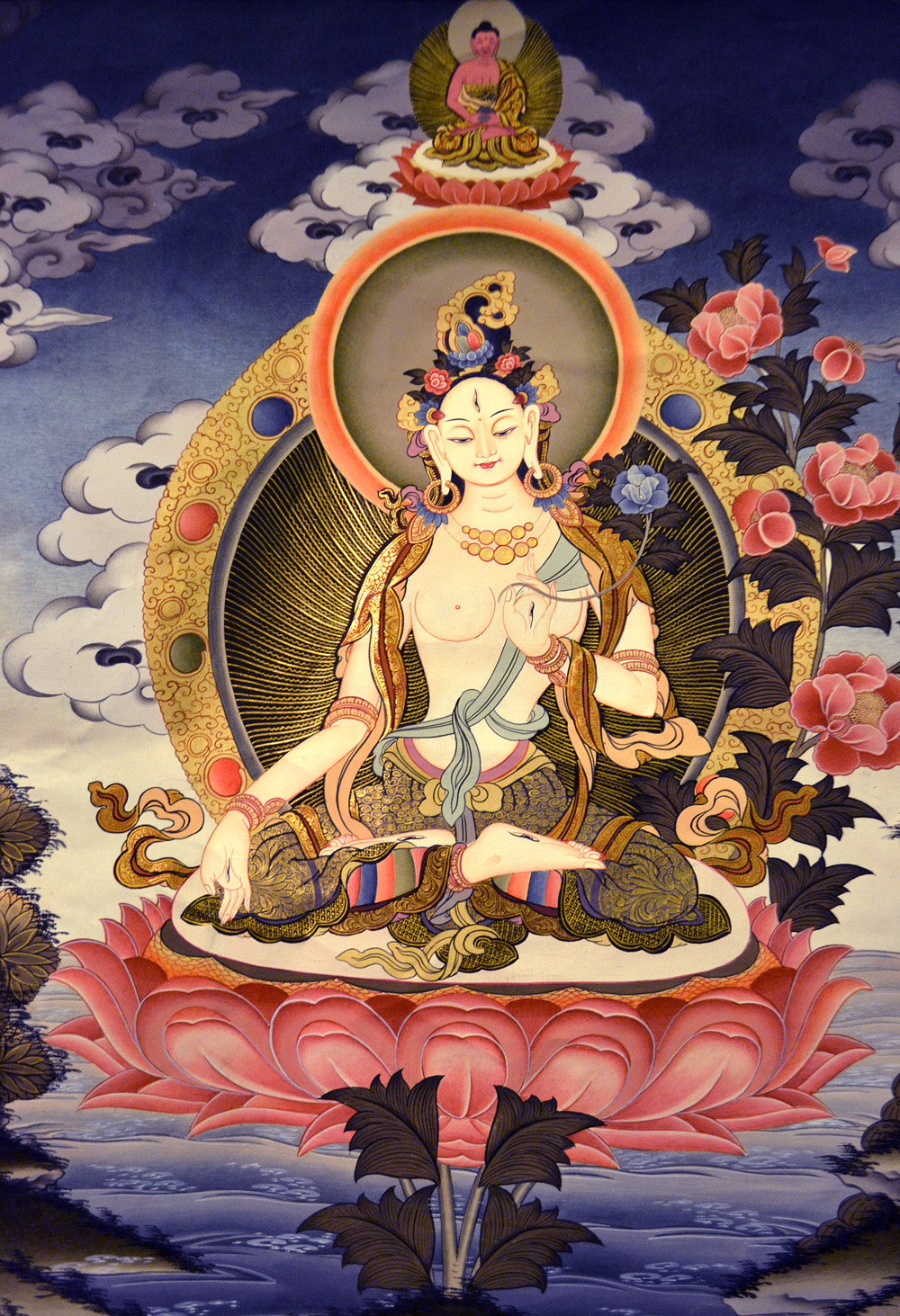 White Tara is the main female Bodhisattva, traditionally associated with the lotus. White Tara in Vegetka is displayed in the lotus position with seven eyes (the eyes, forehead, hands and feet), symbolizing the vision of all the earth, and the ability to help all feeling beings. Photo: Barbora Sajmovicova, 2016, Prague.